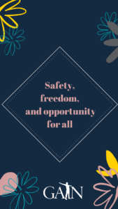 blue wallpaper with flowers that reads safety freedom and opportunity for all